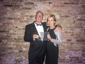 Jim Leishman with award